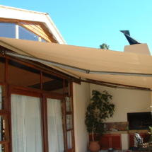 Fold Arm 4700 x 3100 Para Fabric Dis 52 with a bronze powder coated frame to match the window frames in Durbanville Cape Town